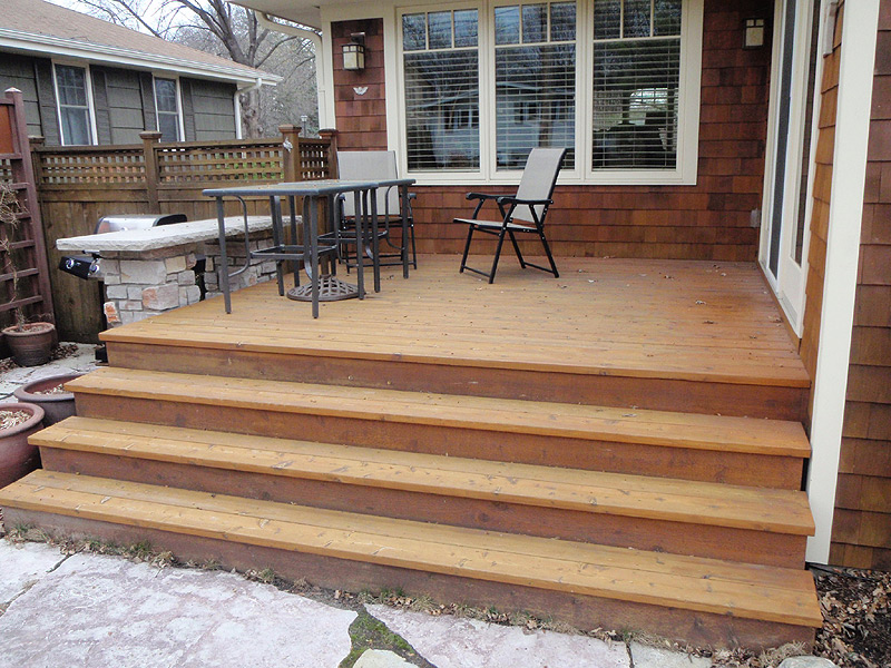 The Deck Was Also Stained At The Same Time As The House.